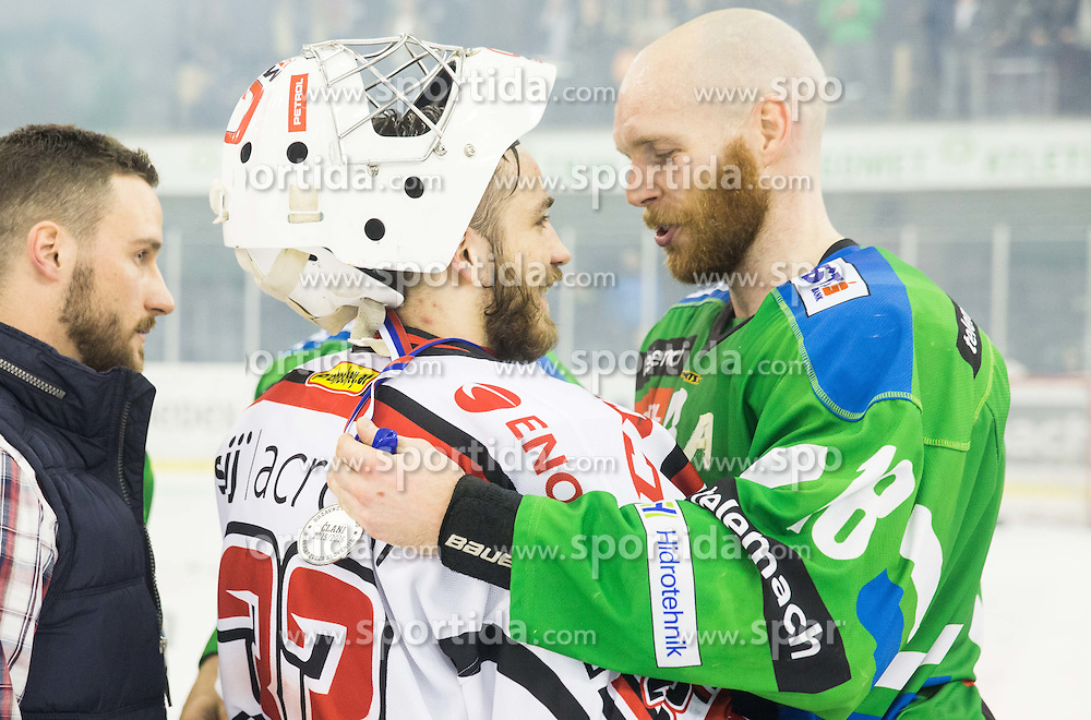 Zan Us of Jesenice and Andrej Tavzelj of Olimpija after the ice hockey match between HDD Telemach Olimpija and HDD SIJ Acroni Jesenice in Final of Slovenian League 2015/16, on April 11, 2016 in Hala Tivoli, Ljubljana, Slovenia. Photo by Vid Ponikvar / Sportida
