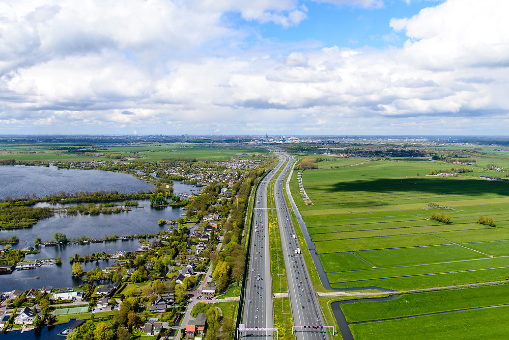 Nederland, Utrecht, Vinkenveen, 28-04-2017; Vinkenveense Plassen met Vinkenkade, en autosnelweg A2 naar Amsterdam, skyline aan de horizon.<br /> Motorway (highway) A2 in the direction of Amsterdam<br /> <br /> luchtfoto (toeslag op standard tarieven);<br /> aerial photo (additional fee required);<br /> copyright foto/photo Siebe Swart