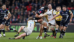Sale's Josh Beaumont is tackled by Wasps' Tommy Taylor and Joe Simpson during the Aviva Premiership match at the AJ Bell Stadium, Sale.