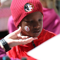 Kayden Gaines, 7, gets his face painted Saturday at the Easter Egg Hunt at Veterans park