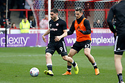 Brentford Forward Neal Maupay (9) warms up before kick off during the EFL Sky Bet Championship match between Brentford and Ipswich Town at Griffin Park, London, England on 7 April 2018. Picture by Andy Walter.