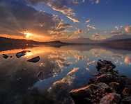 A relaxing, peaceful view at sunset of the Lake of Viverone, one of the many glacial lakes lying in the plain at the feet of the Alps. Taken on somewhat cloudy and windy night of mid March, at sunset. This is a stitch of three vertical takes.