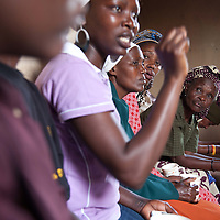 Members of the Mathare Gender Defenders and the Bunge La Wamama (or Women's Parliament) meet with Beatrice at the community center in Mathare to discuss issues of current concern.