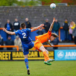 Gloucesters Keiron Thomas and Briantrees Ben Wyatt during the Vanorama National League South match between Braintree Town FC and Gloucester City FC at the IronmongeryDirect Stadium, Essex on 28 April 2018. Photo by Matt Bristow.