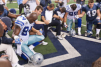 06 November 2011: Linebacker (94) DeMarcus Ware of the Dallas Cowboys prays with teammates and Seattle Seahawks' players after the Cowboys 23-13 victory over the Seahawks at Cowboy Stadium in Arlington, TX.