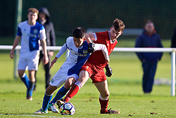 BLACKBURN, ENGLAND - Saturday, January 6, 2018: Liverpool's Liam Millar and Blackburn Rovers' Matty Chan during an Under-18 FA Premier League match between Blackburn Rovers FC and Liverpool FC at Brockhall Village Training Ground. (Pic by David Rawcliffe/Propaganda)