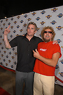 Rockers Sammy Hagar, right, and Mark McGrath, of Sugar Ray, pose for photos on the red carpet during the opening of The Kitchen restaurant at the Hard Rock Cafe Hotel at the Universal Orlando Resort in Orlando, Florida.