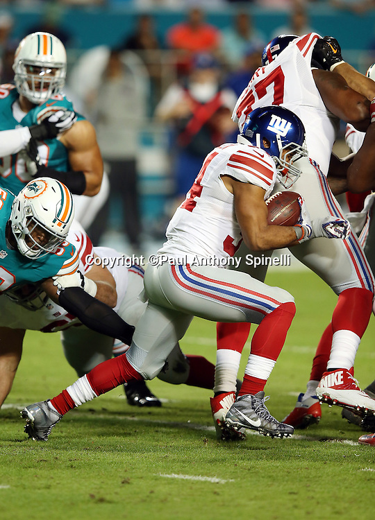New York Giants running back Shane Vereen (34) runs short of a first down on a third down play in the first quarter during the NFL week 14 regular season football game against the Miami Dolphins on Monday, Dec. 14, 2015 in Miami Gardens, Fla. The Giants won the game 31-24. (©Paul Anthony Spinelli)