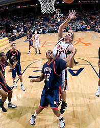 Virginia forward Laurynas Mikalauskas (11) shoots over Howard guard Nate Cooper (32).  The Virginia Cavaliers men's basketball team faced the Howard Bison at the John Paul Jones Arena in Charlottesville, VA on November 14, 2007.