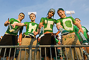 Ohio University students painted in the school colors green and white spelling O-H-I-O attend the football game opener against the University of Connecticut on Saturday, September 5, 2009.