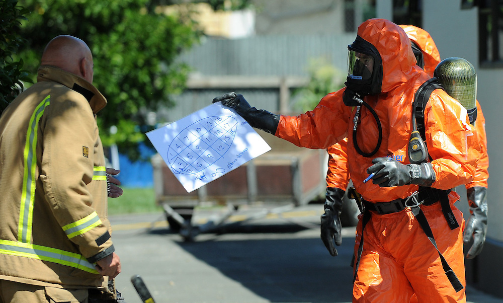 Firefighters clean up a mercury spill in Kennedy Road, Napier, Monday, December 23, 2013. Credit: SNPA / Kerry Marshall