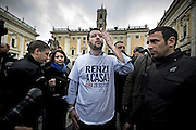 Roma 25th feb 2015, leader and parliamentarians of Lega Nord party, demonstrates at Campidoglio's Square, demanding the resignation of mayor of Rome. In the picture Matteo Salvini with a t-shirt reading ' Renzi go home '; with hand sends kisses to a group of women that are protesting against him