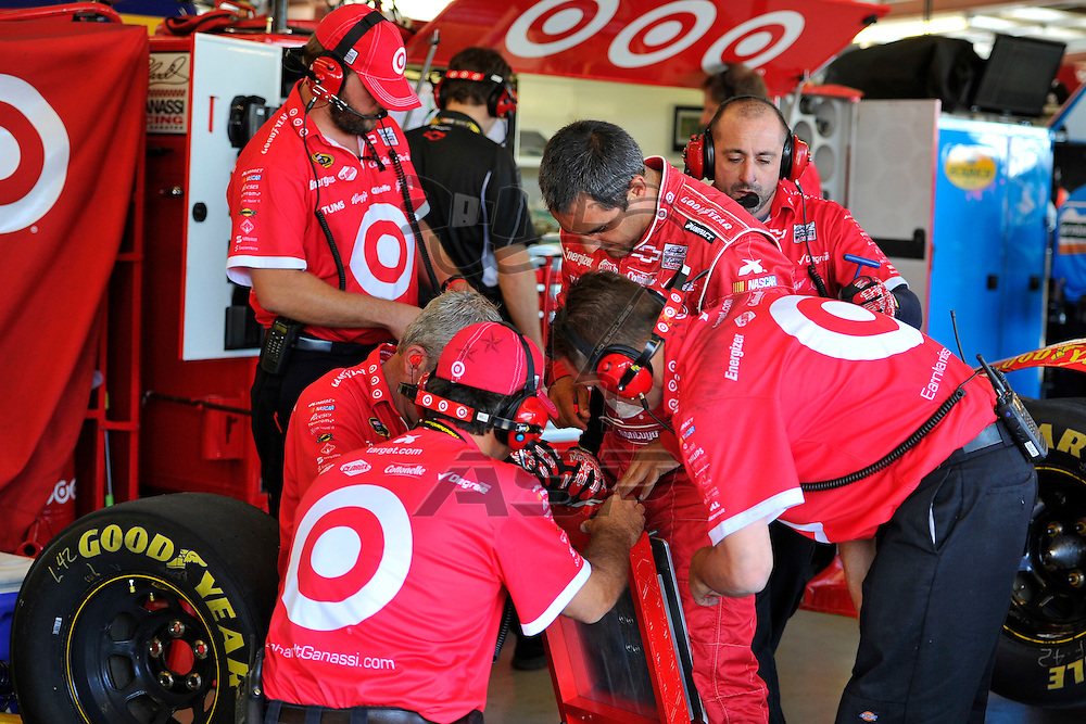 Joliet, IL - SEP 14, 2012: Juan Pablo Montoya (42) and crew members work on gear during practice for the Geico 400 at the Chicagoland Speedway in Joliet, IL.