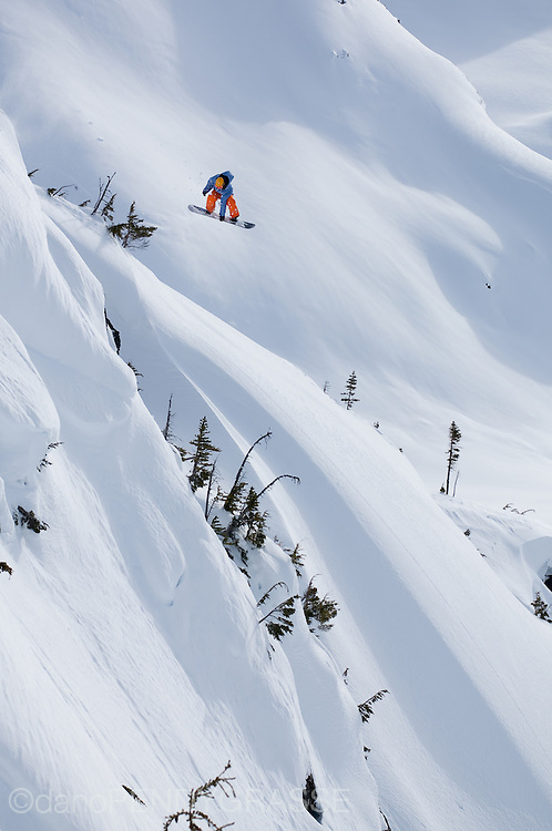 Professional snowboarder Eric Jackson soars above a winter landscape outside of Terrace, British Columbia, Canada.