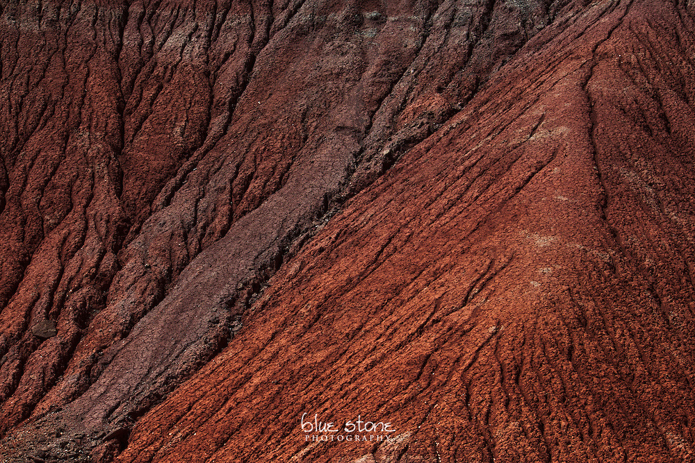 An abstract erosion pattern in red rock represents how misgivings undermine trust.<br />