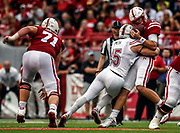 Nebraska Cornhuskers quarterback Tanner Lee (13) is sacked by Northern Illinois Huskies defensive end Sutton Smith (15) during a game on Saturday at Memorial Stadium in Lincoln. (Matt Gade / Republic)