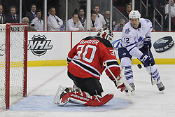 Mar 23; Newark, NJ, USA; New Jersey Devils goalie Martin Brodeur (30) makes a save on Toronto Maple Leafs center Tim Connolly (12) during the first period at the Prudential Center.