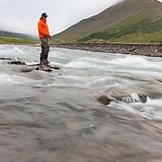 Jökull Bergmann fly fishing at the river Skíðadalsá, North Iceland.