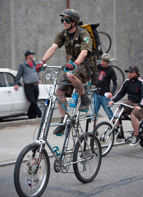 2011 August 05 - A man rides a tall bike along Airport Way S after the Dead Baby Downhill in Georgetown, Seattle, WA. Photo by Richard Walker