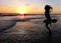 Rheana plays on the beach during the sunset Wednesday, Aug. 11, 2010 in Oceanside, California.