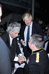 Left to right, KEITH RICHARDS and Mayor of London BORIS JOHNSON meet MAJOR PETER NORTON at the GQ Men of the Year 2011 Awards dinner held at The Royal Opera House, Covent Garden, London on 6th September 2011.