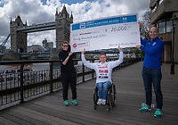 David Weir flanked by Michelle Weltman, Elite Wheelchair Coordinator, Abbott World Marathon Majors and Chris Miller DVP, Global Brand Strategy & Innovation, Abbott accepts a cheque on behalf of the Weir Archer Academy from Abbott World Marathon Majors for £20,000 to mark his 20th consecutive London Marathon at a photocall for Elite Wheelchair athletes at the Guoman Tower Hotel. The Virgin Money London Marathon, 25 April 2018.<br />