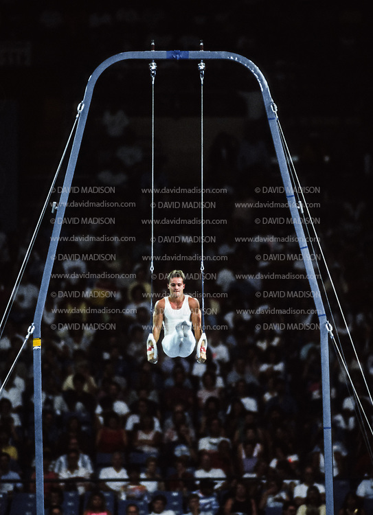 SEATTLE - JULY 1990:  Csaba Fajkusz of Hungary performs on the rings during the Men's Gymnastics competition of the 1990 Goodwill Games held from July 20 - August 5, 1990.  The gymnastics venue was the Tacoma Dome in Tacoma, Washington.  (Photo by David Madison/Getty Images)