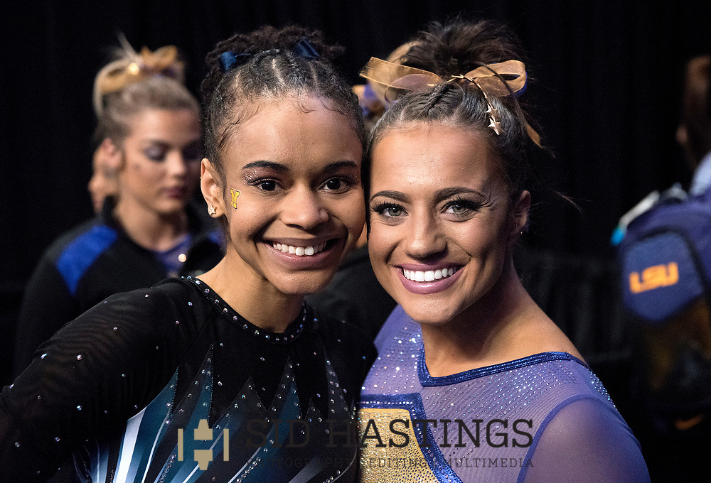 20 APRIL 2018 -- ST. LOUIS -- LSU gymnast Lexie Priessman (right) and Michigan gymnast Brianna Brown pose for a photo during the bye preceding the Uneven Parallel Bars during the 2018 NCAA Women's Gymnastics Championship Semifinals in St. Louis Friday, April 20, 2018. LSU finished second in the semifinal, joining UCLA and Nebraska in advancing from the first semifinal into the Super Six championship round on Saturday.<br /> <br /> Photo &copy; copyright 2018 Sid Hastings.