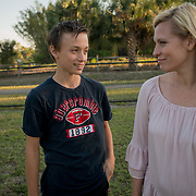 ROYAL PALM BEACH, FLORIDA, MARCH 15, 2017<br /> Cynthia Greaux and her son Tyler, 14,  in the dog park a short walk from their house. Their mother Cynthia Greaux is able to use vouchers to pay for Tyler and sister Chloe's enrollment at a private school that specializes in educating children with dyslexia.<br /> (Photo by Angel Valentin/Freelance)