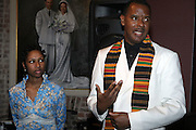 l to r: Shantrell P. Lewis and Jamel Shabazz at ' Shoot-Out: Lonely Crusade..An Homage to Jamel Shabazz ' held at The George and Leah McKenna African American Museum of Art on December 12, 2008 in New Orleans, Louisana