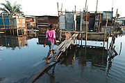 A girl walks up to a latrine on stilts in the Clara town slum in Monrovia, Montserrado county, Liberia on Thursday April 5, 2012.