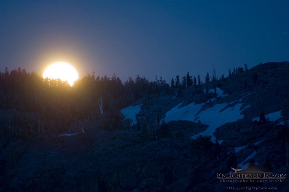 Full moon rising in evening over mountain ridge, Desolation Wilderness, El Dorado National Forest, California