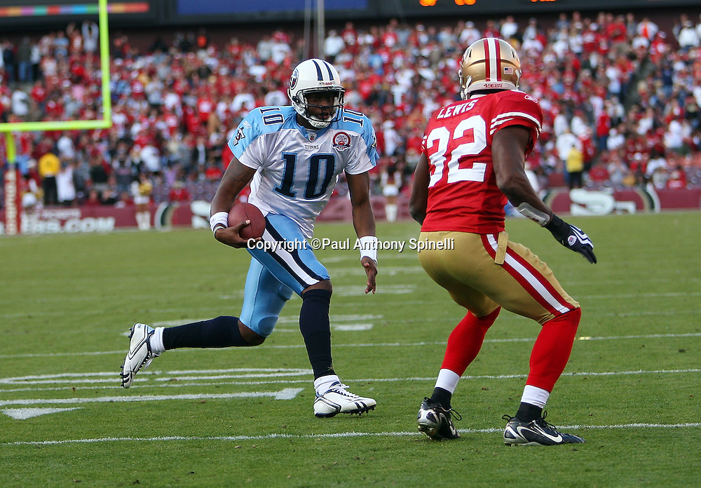 Tennessee Titans quarterback Vince Young (10) runs the ball while pursued by San Francisco 49ers safety Michael Lewis (32) during the NFL football game against the San Francisco 49ers, November 8, 2009 in San Francisco, California. The Titans won the game 34-27. (©Paul Anthony Spinelli)
