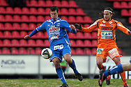 23.04.2010, Ratina, Tampere..Veikkausliiga 2010, Tampere United - JJK Jyv?skyl?..Juha Pirinen (TamU) v Christian Sund (JJK).©Juha Tamminen.