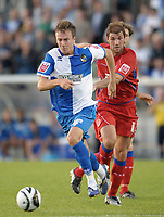 Football<br /> Bristol Rovers vs Aldershot Town, Carling Cup 1st Round, Memorial Stadium, Bristol, UK<br /> Chris Lines of Bristol Rovers and Scott Donnelly of Aldershot Town <br /> 11/08/2009<br /> Credit Colorsport/Dan Rowley