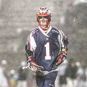 Will Manny #1 of the Boston Cannons runs of the field prior to a rain delay during the game at Harvard Stadium on May 10, 2014 in Boston, Massachusetts. (Photo by Elan Kawesch)