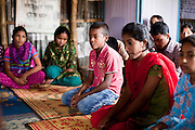 """Oli Ahmed (11, in pink shirt) speaks during a monthly meeting of a Children's Group in Bhashantek Basti (Slum) in Zon H, Dhaka, Bangladesh on 23rd September 2011. Oli says, """"We are in extreme poverty. If our parents get a good price for our marriages, there is nothing we can do. (Also,) we are now in the era of gender equality and girls should be allowed to study instead of being married off."""" Oli wants to be a doctor when he grows up. The Bhashantek Basti Childrens Group is run by children for children with the facilitation of PLAN Bangladesh and other partner NGOs. Slum children from ages 8 to 17 run the group within their own communities to protect vulnerable children from child related issues such as child marriage. Photo by Suzanne Lee for The Guardian"""