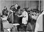 Sir Evelyn Baring presents a Medal of Excellence to Mr. Sebit of the Nubian community at the State House for his service in the King's African Rifles.  (1956)