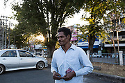 Yaaw stands in the carpark of the Municipality building after he attended a meeting about Maniq citizenship issues organized by the National Human Rights Commission of Thailand.<br /> <br /> Evidence suggests that the Maniq, a Negrito tribe of hunters and gatherers, have inhabited the Malay Peninsula for around 25,000 years. Today a population of approximately 350 maniq remain, marooned on a forest covered mountain range in Southern Thailand. Whilst some have left their traditional life forming small villages, the majority still live the way they have for millennia, moving around the forest following food sources. <br /> <br /> Quiet and reclusive they are little known even in Thailand itself but due to rapid deforestation they are finding it harder to survive on the forest alone and are slowly being forced to move to its peripheries closer to Thai communities.