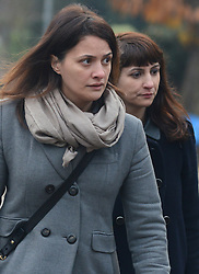 © Licensed to London News Pictures.10/12/2013. London, UK. Italian Sisters Elisabetta 'Lisa' (L) and Francesca (in dark jacket) Grillo, who are the former personal assistants to Charles Saatchi and Nigella Lawson, arriving at Isleworth Crown Court in London. The pair, who face fraud charges, are accused of misappropriating funds while working for Saatchi and Lawson.Photo credit : Peter Kollanyi/LNP
