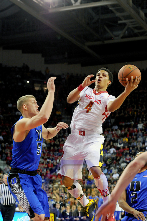 16 February 2013:   Maryland Terrapins guard Seth Allen (4) in action against Duke Blue Devils forward Mason Plumlee (5) at the Comcast Center in College Park, MD. where the Maryland Terrapins upset the second ranked Duke Blue Devils, 83-81.