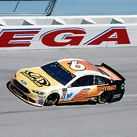 Matt Kenseth (6) brings his car through the turn 4 during practice for the 1000Bulbs.com 500 at Talladega Superspeedway in Talladega, Alabama.