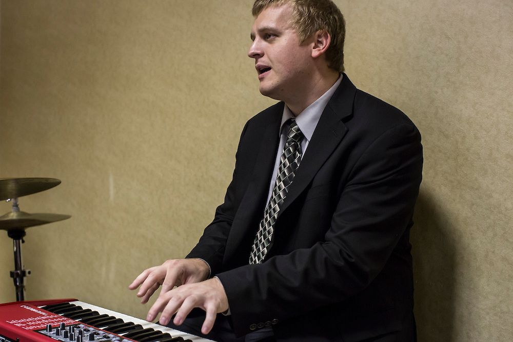 A keyboardist performs with his band at a Democratic LDS caucus meeting during the Democratic National Convention on Tuesday, September 4, 2012 in Charlotte, NC.