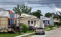 29 May 2014. New Orleans, Louisiana.<br /> Brad Pitt's Make it Right foundation architect inspired, eco friendly homes mix with standard housing in the Lower 9th Ward. <br /> Charlie Varley/varleypix.com
