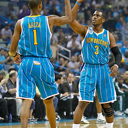 October 27, 2010; New Orleans, LA, USA; New Orleans Hornets small forward Trevor Ariza (1) celebrates with point guard Chris Paul (3) after a score against the Milwaukee Bucks during the first quarter at the New Orleans Arena. Mandatory Credit: Derick E. Hingle