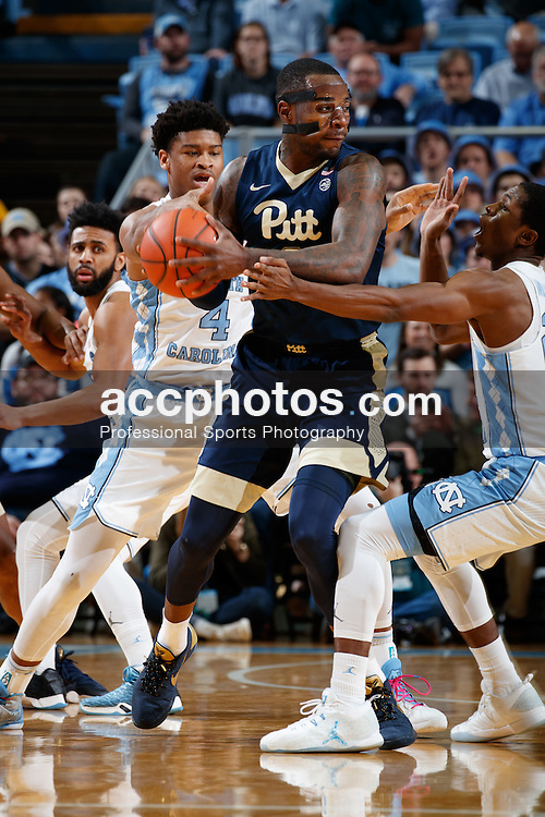 CHAPEL HILL, NC - JANUARY 31: Michael Young #2 of the Pittsburgh Panthers is pressured by Isaiah Hicks #4 and Kenny Williams #24 of the North Carolina Tar Heels on January 31, 2017 at the Dean Smith Center in Chapel Hill, North Carolina. North Carolina won 80-78. (Photo by Peyton Williams/UNC/Getty Images) *** Local Caption *** Michael Young;Isaiah Hicks;Kenny Williams