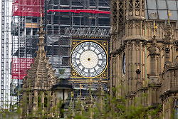 "© Licensed to London News Pictures. 15/04/2018. London, UK. A clock face on the Elizabeth Tower, (commonly known as ""Big Ben""), is seen without hour and minute hands. The Houses of Parliament is currently undergoing a large scale renovation. Photo credit : Tom Nicholson/LNP"