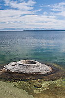 Fishing Cone Geyser is found along the shore of Yellowstone Lake at West Thumb. Yellowstone National Park, Wyoming, USA.