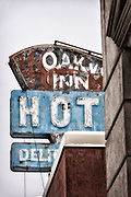 Dilapidated sign with unintended innuendo