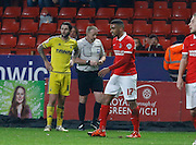 Charlton Athletic defender Tareiq Holmes-Dennis earns himself a second yellow and a red card during the Sky Bet Championship match between Charlton Athletic and Nottingham Forest at The Valley, London, England on 2 January 2016. Photo by Andy Walter.